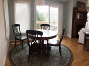 10 3rd Flr Small Dining Venue in Family Room Shows Full Deck in Background