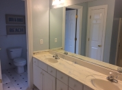 15 2nd Floor Master Bath Has Tub and Shower Combination and Separate Room with Two Vanities and Tiled Shower