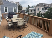 6 Family Room Deck 3rd Flr with Table that Seats 6 and Large Gas Grill